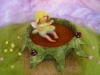Fairy baby in a nest with ladybugs