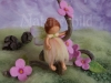 Little fairy on a twig