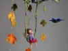 Fairy on a swing with humming birds mobile