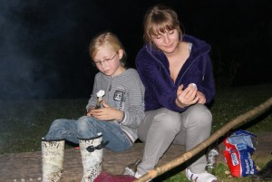 Mia and Lisa roasting marshmellows