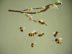 mobile with seven felted bees